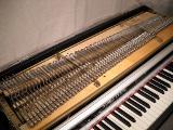 Fresh zinc plating on the tone bars and harp frame.